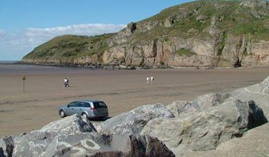 Brean Down beach view car parking rocks sand cliffs